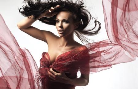 Foto de Sexy brunette in the windy day - Imagen libre de derechos