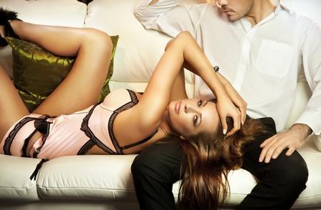 Photo pour Cute brunette in lingerine posing with a man - image libre de droit
