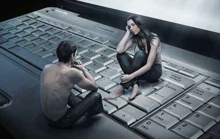 Conceptual photo of a couple sitting on laptop