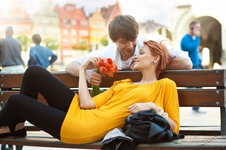 Romantic young couple relaxing outdoors smilingの写真素材