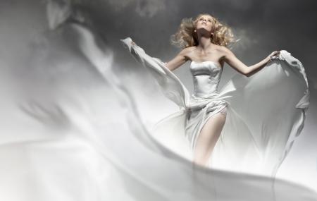 Beautiful young bride posing in amazing dress