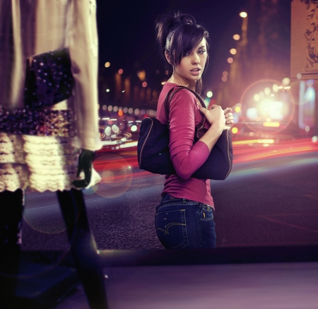 Photo for Walking woman looking at shop window - Royalty Free Image