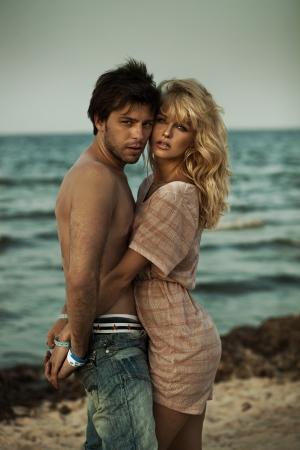 Attractive couple hugging in romantic scenery