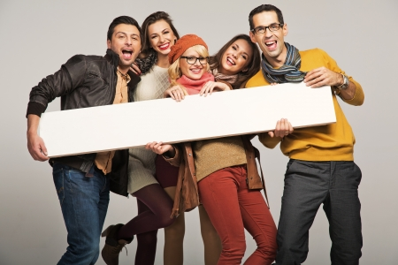 Group of smiling people with empty board