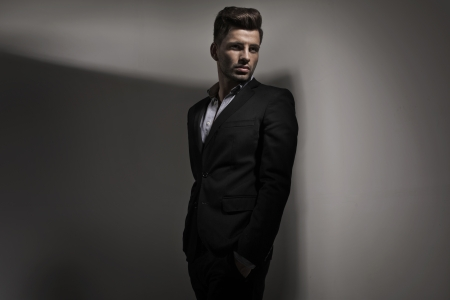 Fashion style photo of young guy dressed in suit