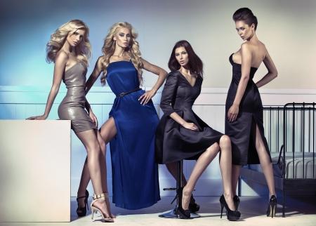 Photo pour Fashion photo of four attractive female models - image libre de droit