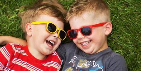Smiling young brothers wearing fancy sunglasses