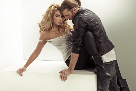 Man wearing leather jacket and his sensual wife