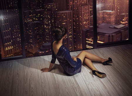 Attractive brunette woman looking at the panorama of the city