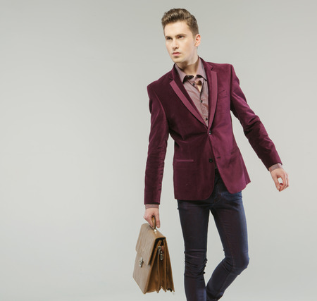 Handsome guy carrying the leather handbag