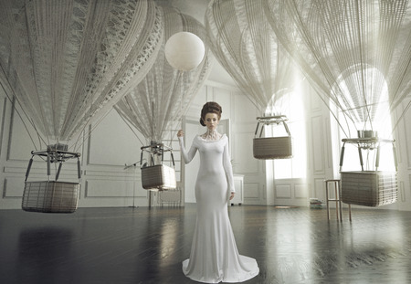 Fine art photo of a young fashion woman in a stylish interior