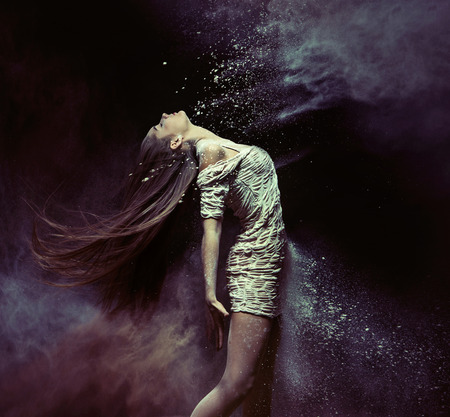 Photo for Young ballet dancer dancing with the colorful dust - Royalty Free Image