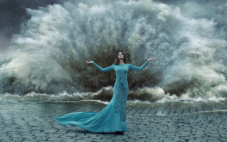 Alluring, elegant lady over the sand&water storm