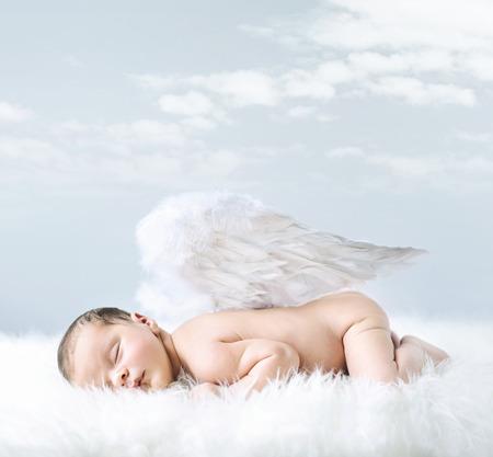 Foto de Portrait of a little baby as an innocent angel - Imagen libre de derechos