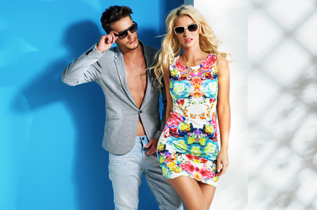 Glamour couple wearing trendy summer clothes