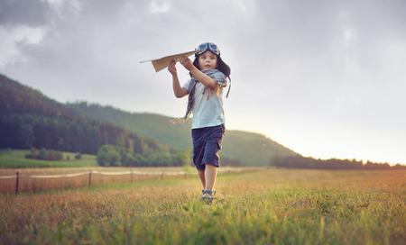 Photo for Cute little boy playing paper plane - Royalty Free Image