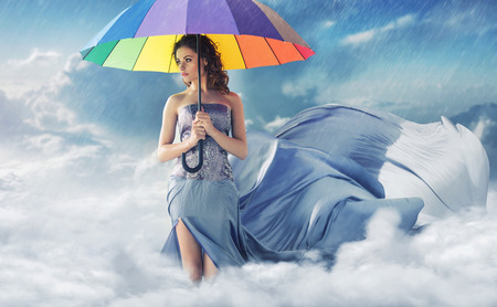Photo for Woman with a colorful wide umbrella - Royalty Free Image
