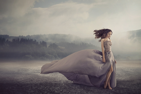 Sensual brunette walking on the fantasy ground