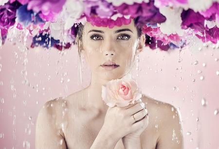 Photo for Wet lady with a huge wreath on her head - Royalty Free Image
