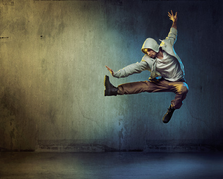 Photo for Athletic dancer in a super jumping pose - Royalty Free Image