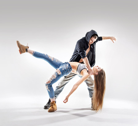 Acrobat pose of a two talented, young dancers