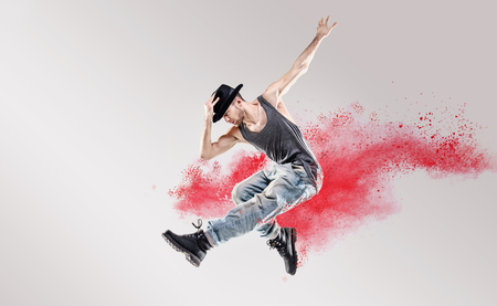 Photo for Conceptual picture of hip hop dancer among red powder - Royalty Free Image