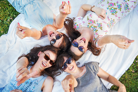 Photo for Four cheerful women in a pointing pose - Royalty Free Image