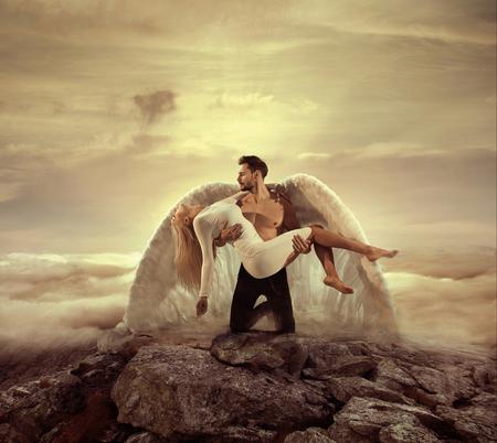 Photo pour Portrait of an archangel carrying a beautiful innocent lady - image libre de droit
