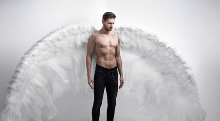 Photo pour Portrtait of the handsome, serious angel - isolated - image libre de droit