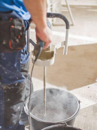 Photo pour concrete electrical mixer during the work ; construction concept - image libre de droit