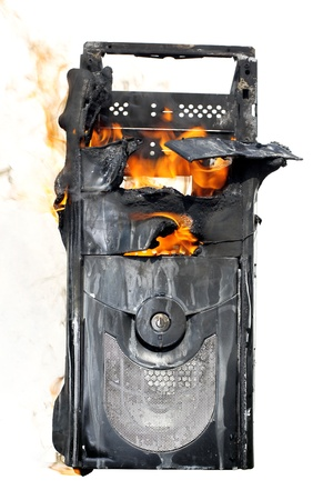 burning computer case isolated on white
