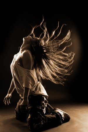 cool woman dancer against black background