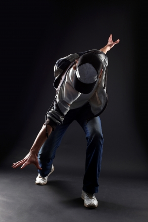 cool man modern dancer against black
