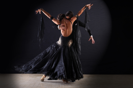 Photo for Dancers in ballroom at black background - Royalty Free Image