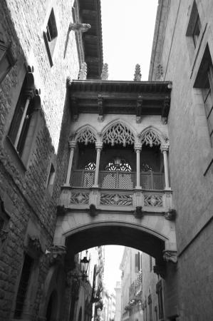 Gothic bridge in Carrer del Bisbe street in Barcelona, Spain. Black and white.