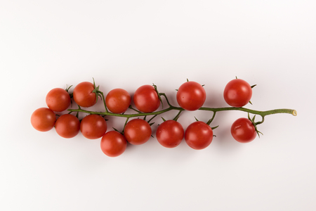 Foto für Cluster of cherry tomatoes on the white isolated background, flat lay - Lizenzfreies Bild