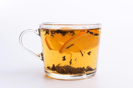 Photo pour Glass cup of hot aromatic tea on white background - image libre de droit