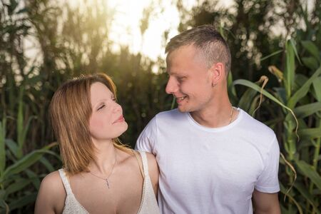 Photo for Loving man and happy woman in a spring blooming park. Happy mature couple in love embracing outdoor, looking each other - Royalty Free Image