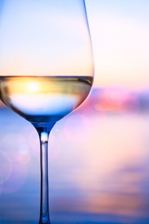 white wine on the summer sea background