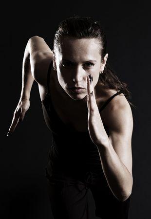 Photo pour woman running over dark background - image libre de droit