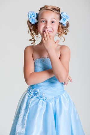 portrait of surprised girl in blue dressの写真素材