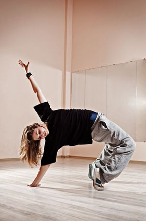 breakdancer standing in bridge. photo in dance studio