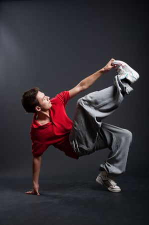 hip-hop guy dancing against dark background