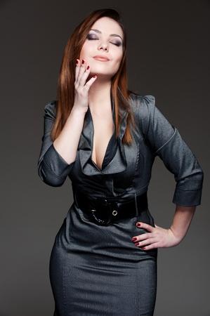 portrait of beautiful woman in dark dress