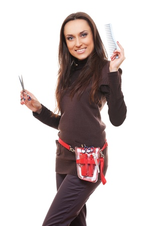 smiley hairdresser with tools against white background