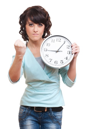 strict young woman holding clock and making threatening gestures. isolated on white background