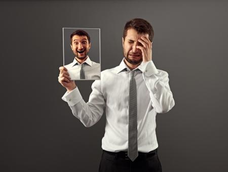 Foto de hypocritical man hiding his gladness - Imagen libre de derechos
