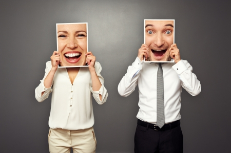 man and woman holding frames with big excited faces