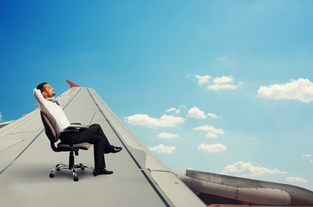smiley businessman flying and resting