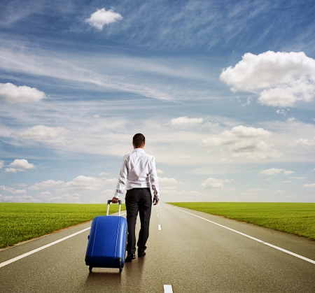 back view of businessman with blue bag